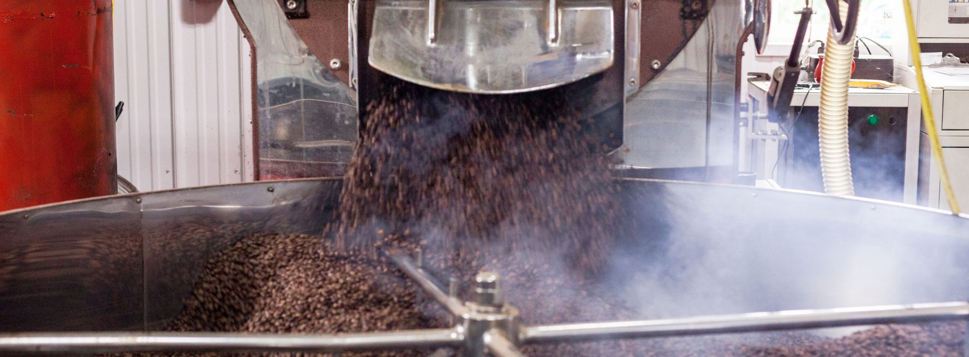 freshly roasted coffee coming out of coffee roaster